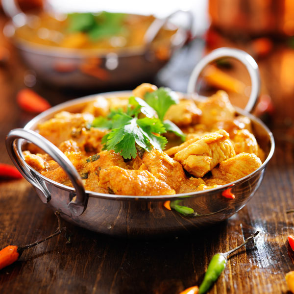 chicken curry in small cooking pot