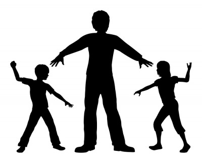 children standing over another child in fear