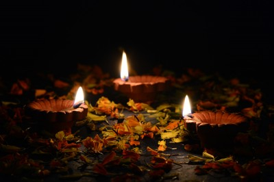Indian Hindu Light Festival called Diwali Clay diya lamps lit during Diwali Celebration. Greetings Card Design
