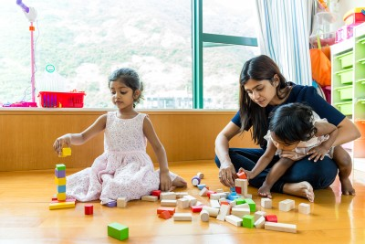 Indian family play toy block together at home