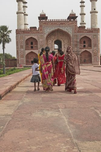 Indian family in brightly colored clothing at the tomb of the Mughal Emperor Akbar in Agra